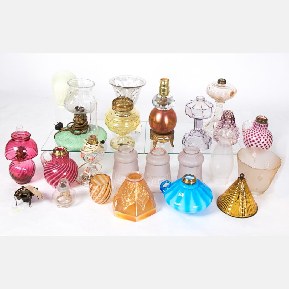A Collection of Colored Pressed and Blown Glass Lamp