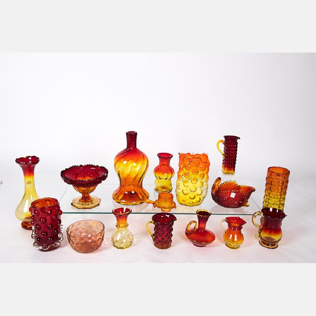 A Collection of Amberina and Cranberry Glass Decorative
