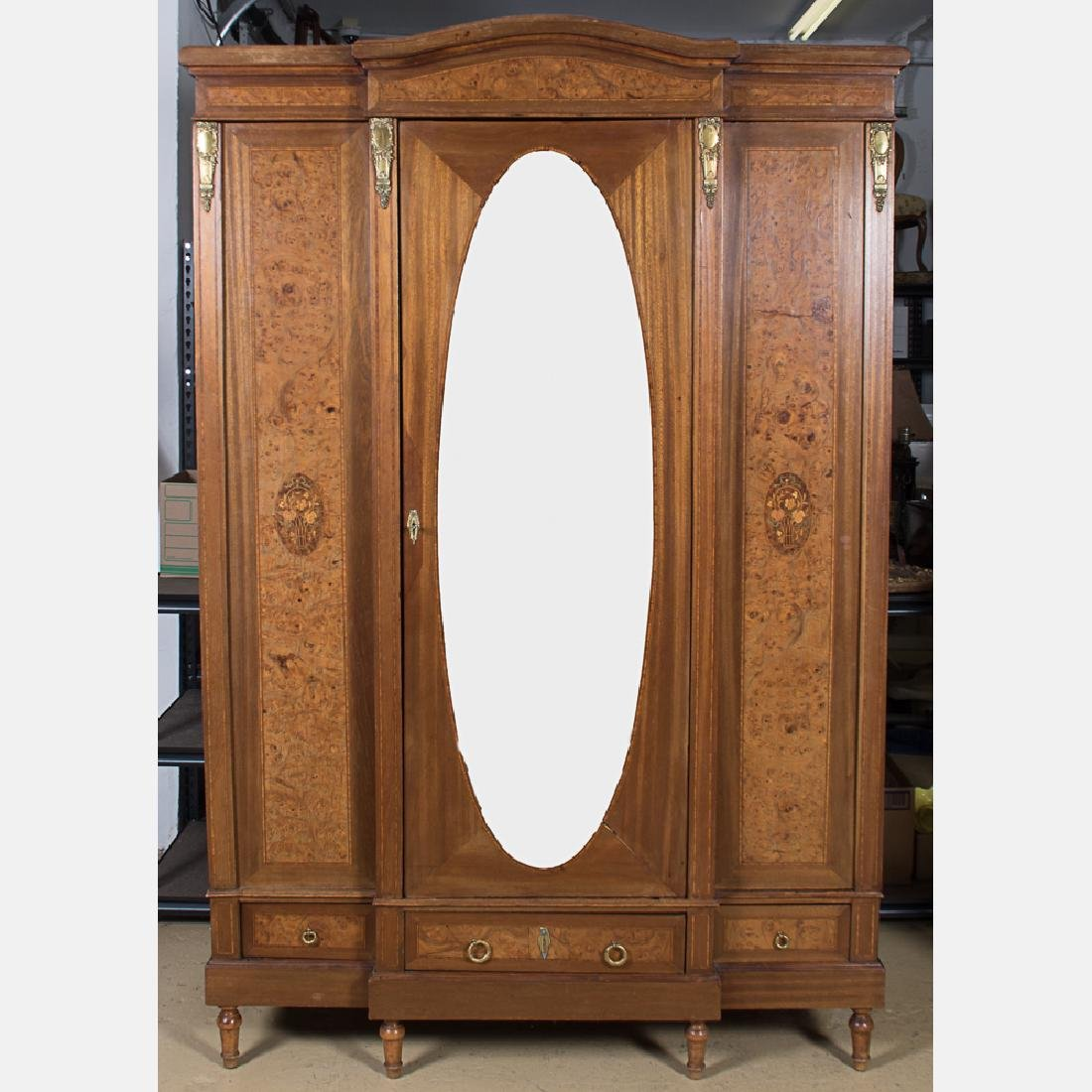 A Louis XVI Style Burlwood Armoire with Fruitwood