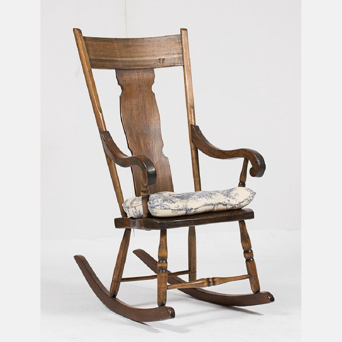 An American Walnut Rocking Chair, Early 20th Century.