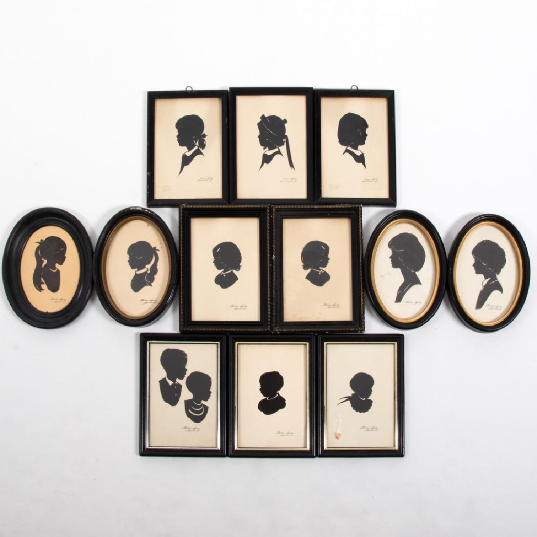 A Collection of Twelve Cut Paper Silhouettes by Wallie