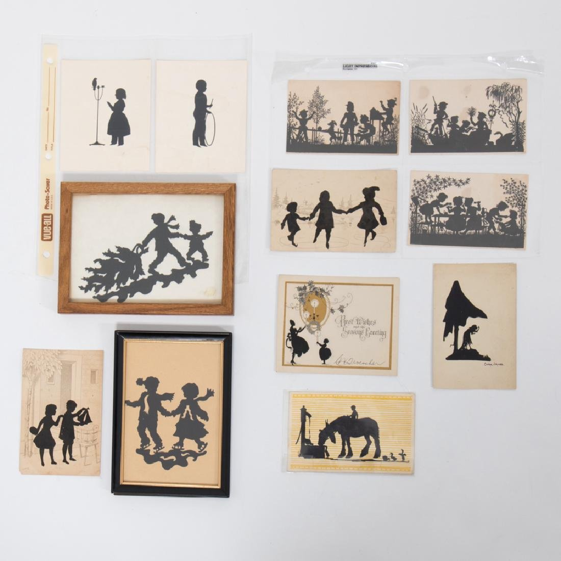 A Collection of Eleven Cut Paper and Ink Silhouettes