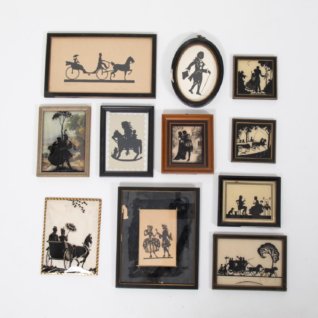 A Collection of Eleven Cut Paper, Ink and Reverse