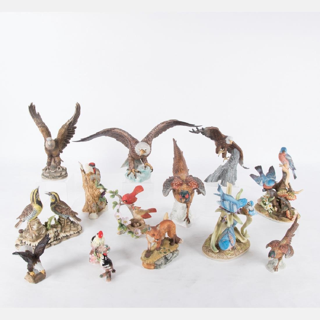 A Collection of Bisque Porcelain Bird and Animal Form
