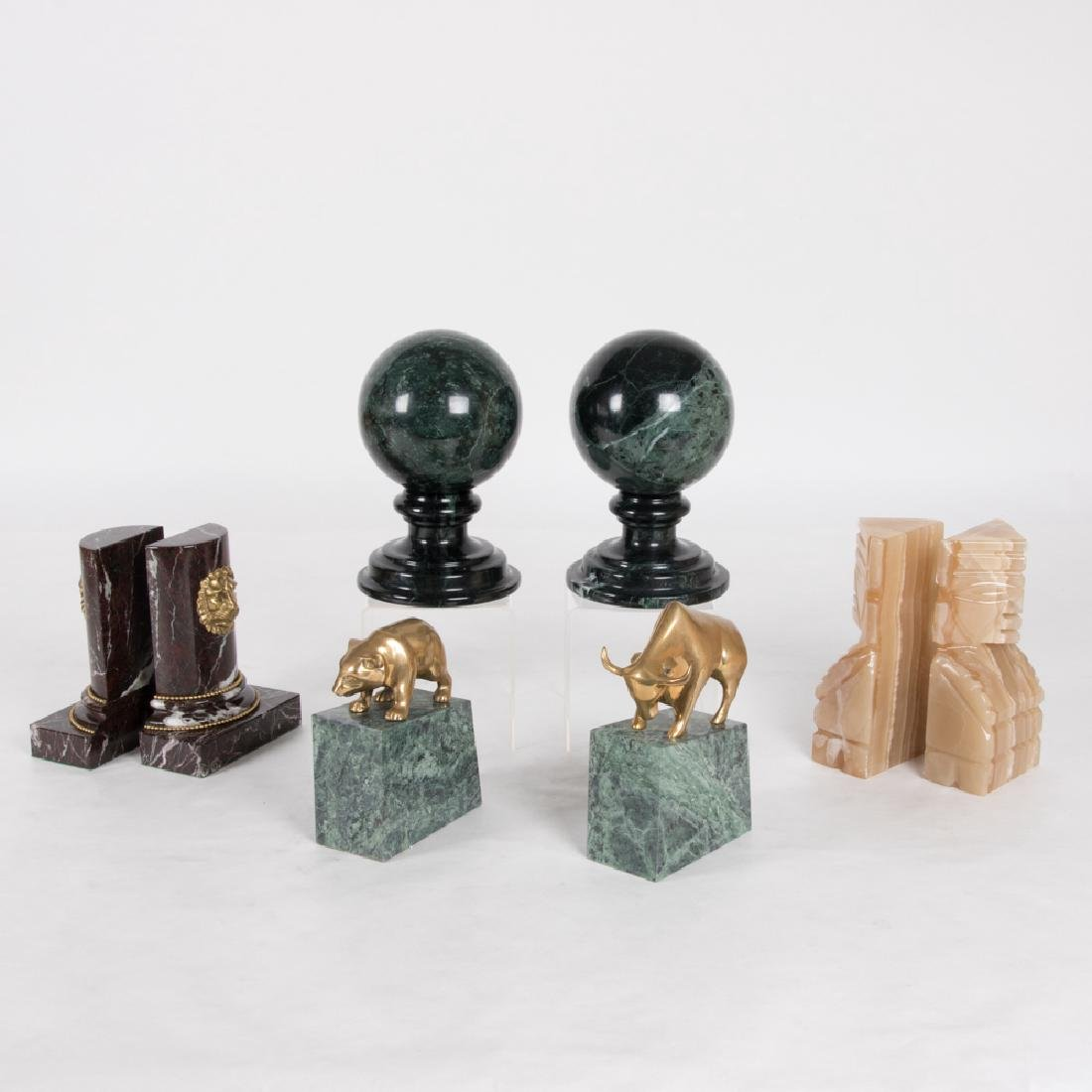 A Collection of Brass and Carved Hardstone Bookend and