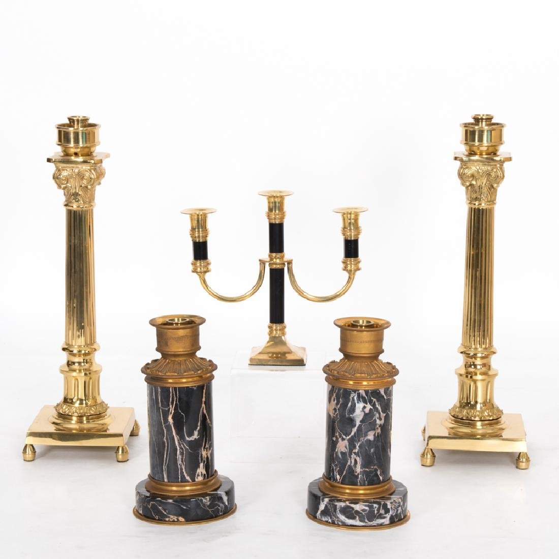 A Collection of Brass Candlesticks and Candelabra, 20th