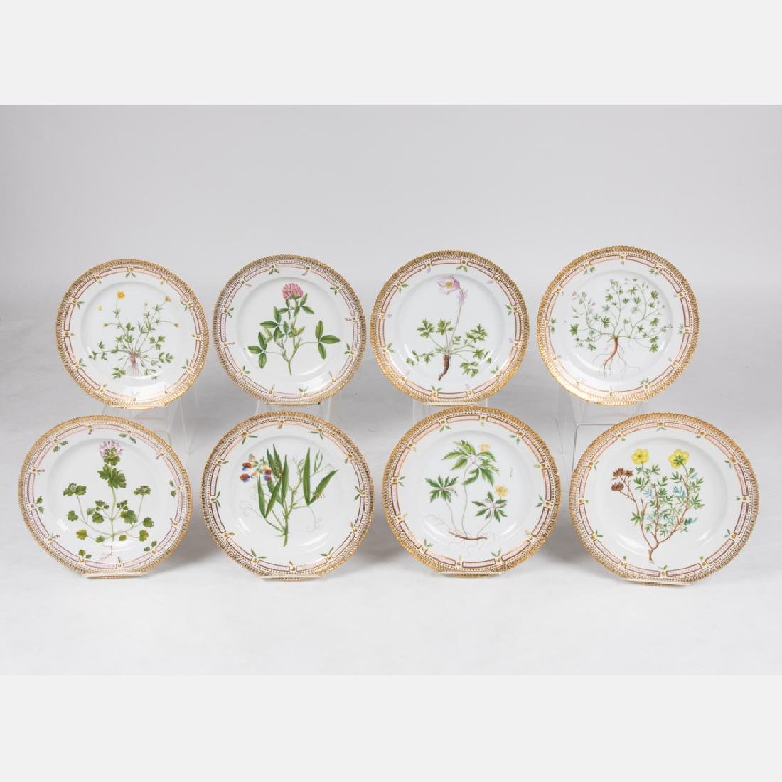 A Set of Eight Royal Copenhagen Porcelain Plates in the