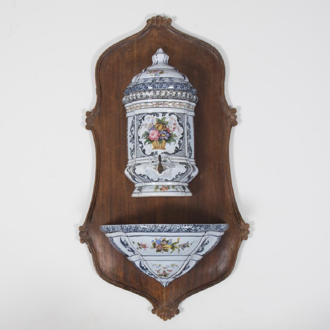 A Continental Porcelain Wall Hanging Lavabo mounted on