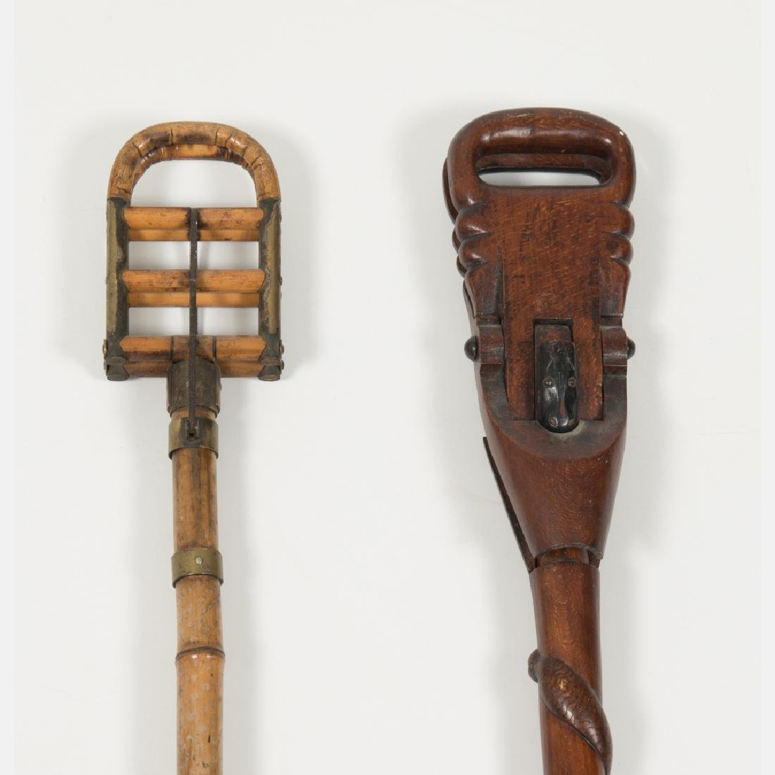 An African Carved Hardwood and Metal Spectator's