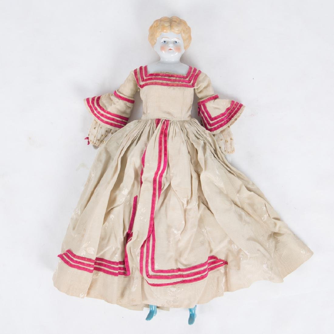 A German Bisque Porcelain Doll with Painted Face,