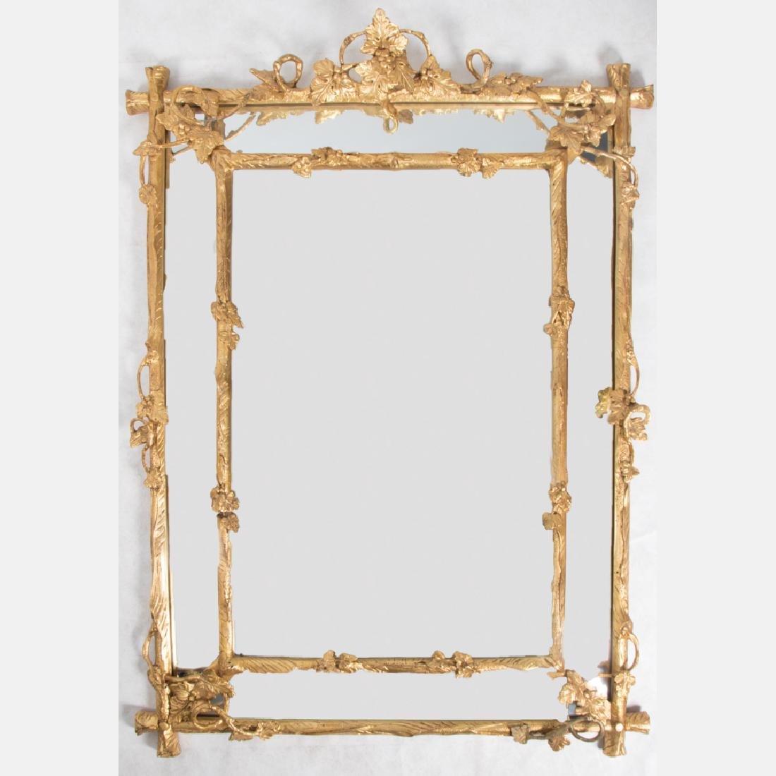 A Gilt Framed Bevel Glass Mirror, 20th Century.
