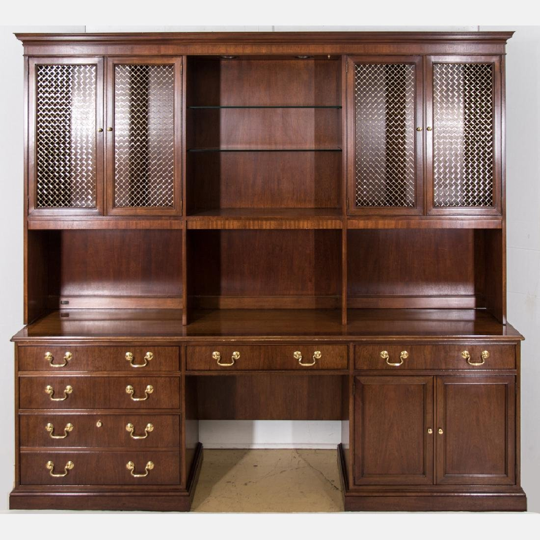A Baker Furniture Georgian Style Walnut and Brass