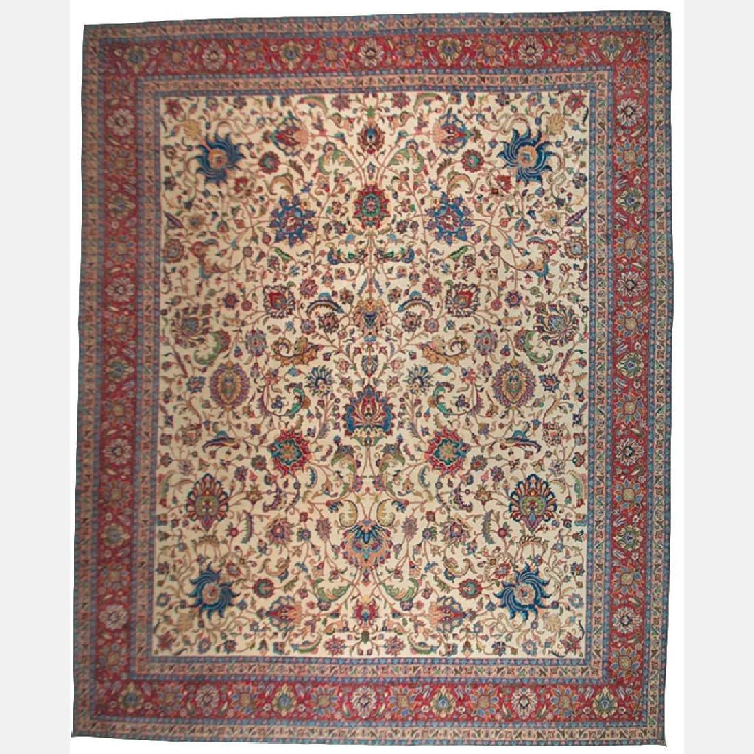 A Persian Mashad Wool Rug, 20th Century.