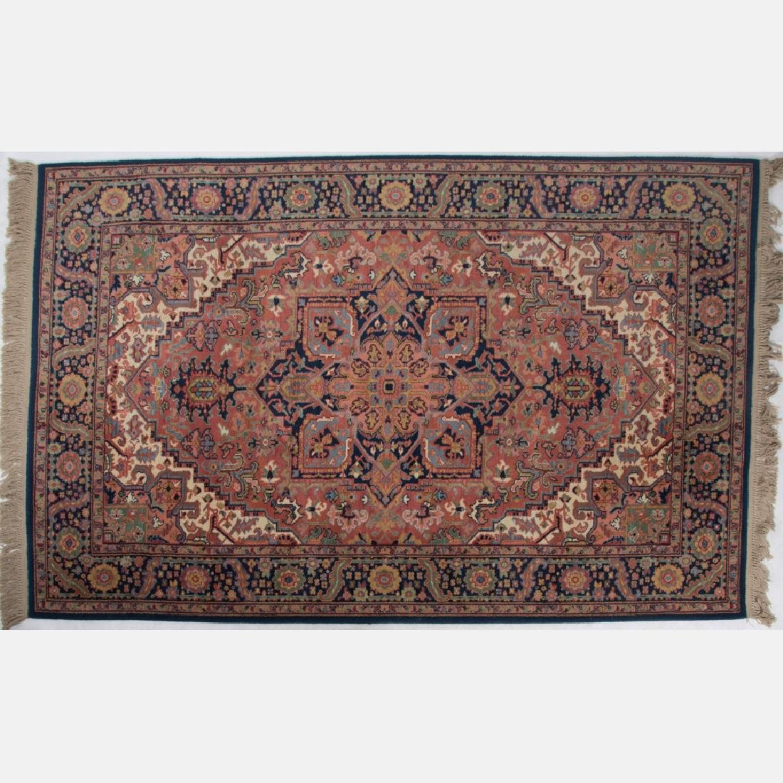 A Persian Machine Made Wool Rug, 20th Century.