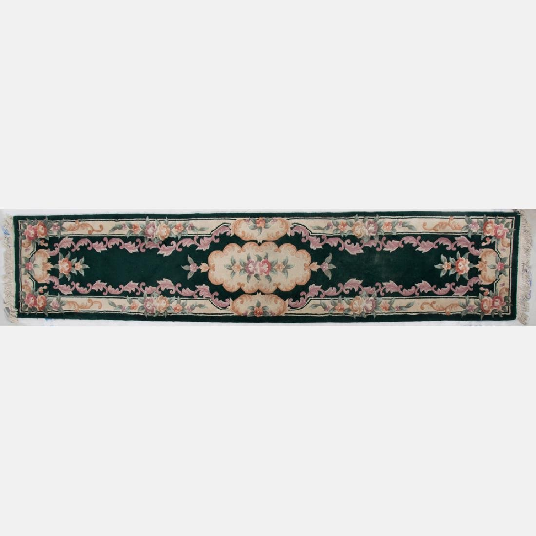 A Persian Machine Made Wool Runner, 20th Century.