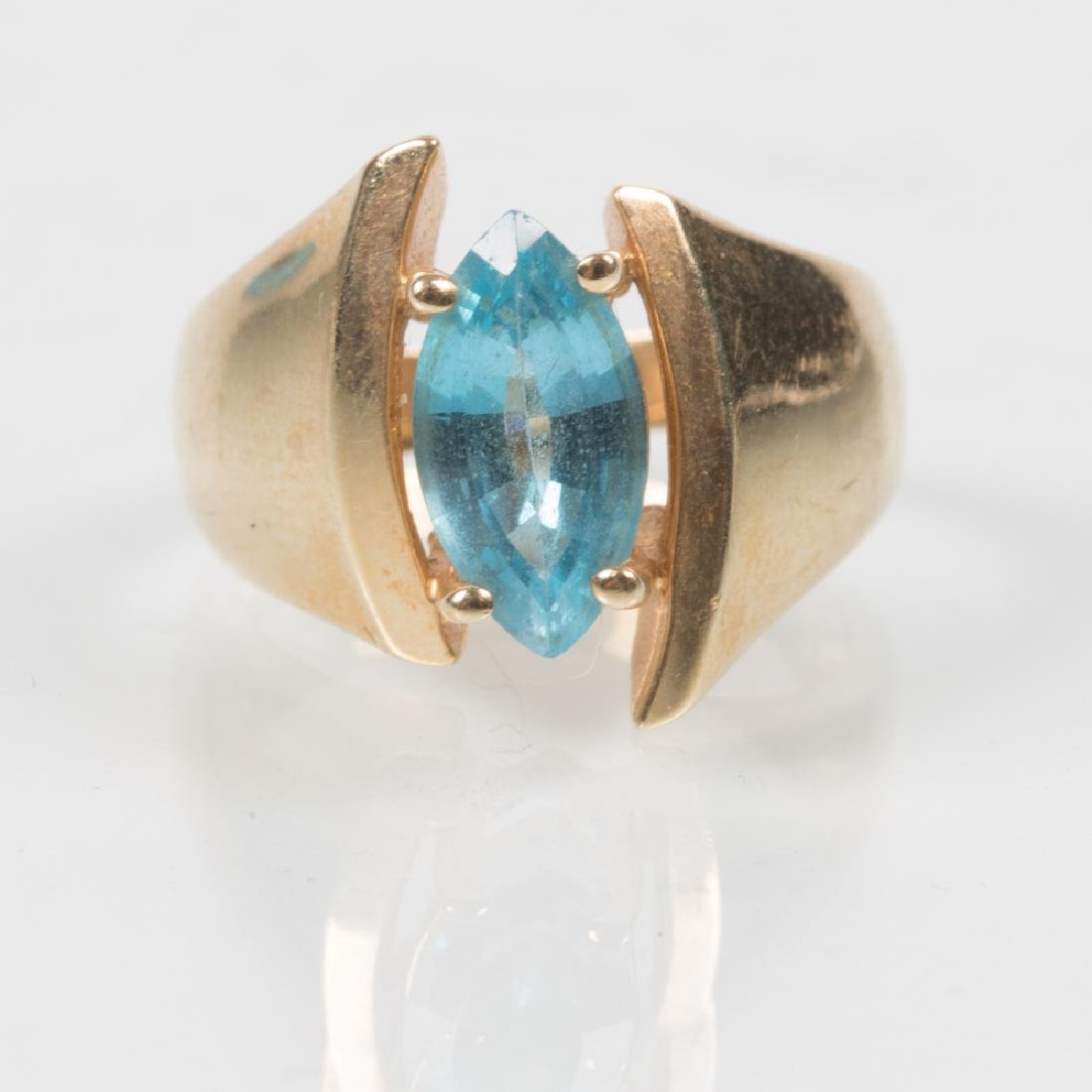 A 14kt. Yellow Gold and Blue Topaz Ring,