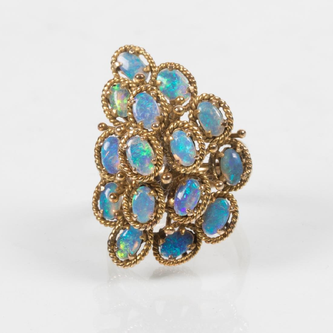 A 14kt. Yellow Gold and Opal Ring,