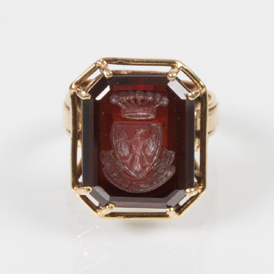 An 18kt. Yellow Gold and Carved Garnet Signet Ring.