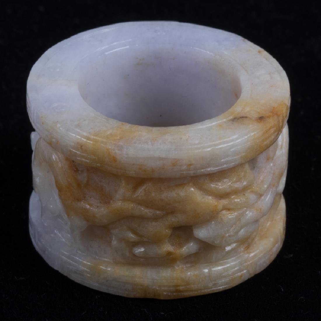 A Carved Lavender and Russet Jade Ring, - 3