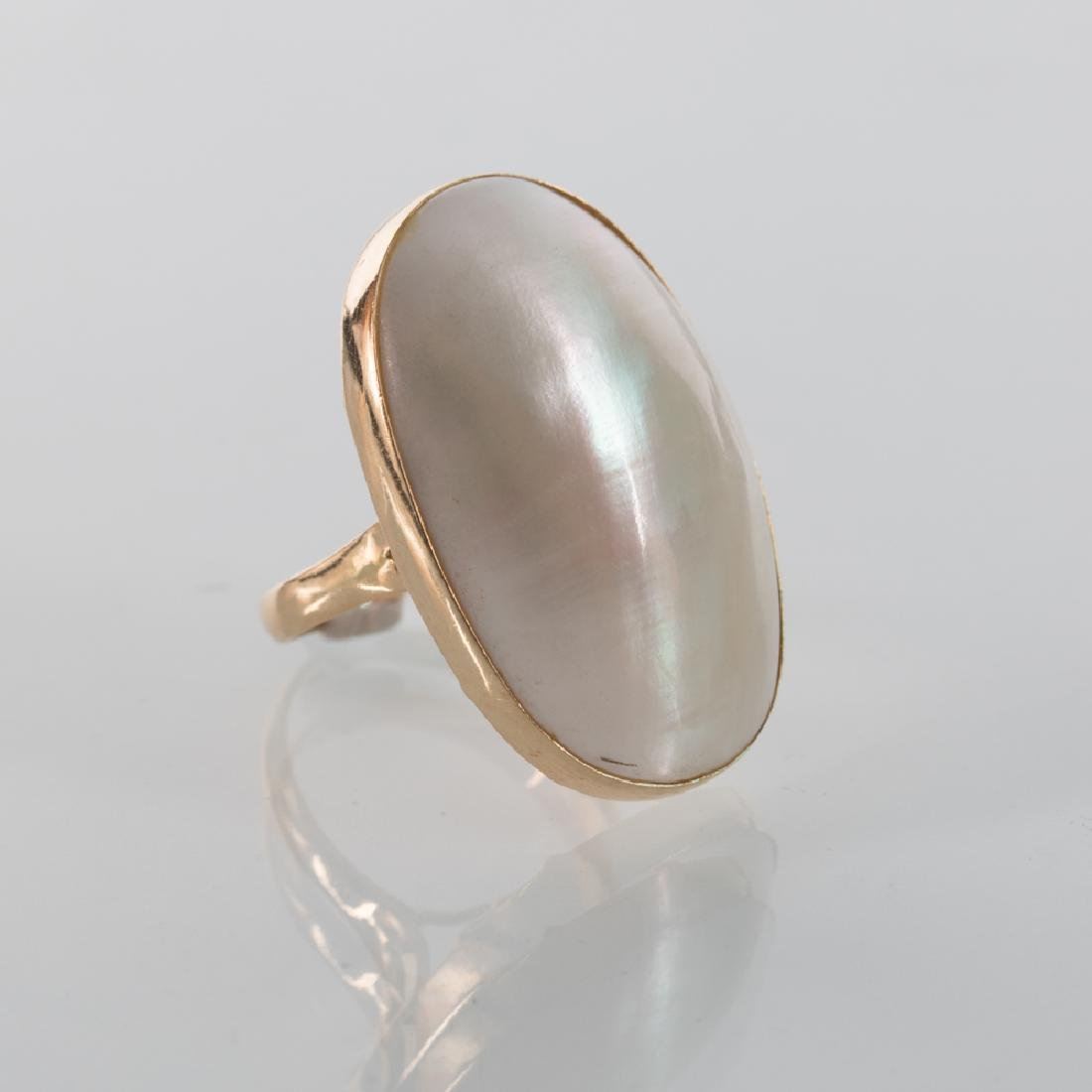 A 14kt. Yellow Gold and Mother of Pearl Ring.
