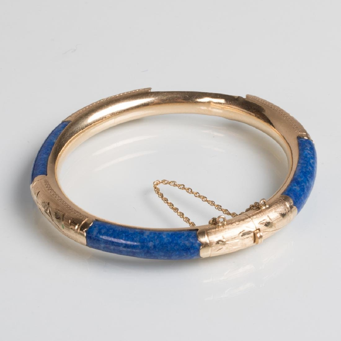 A 14kt. Yellow Gold and Lapis Bangle Bracelet.