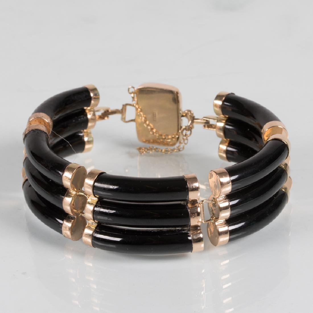 A 14kt. Yellow Gold and Obsidian Bracelet.