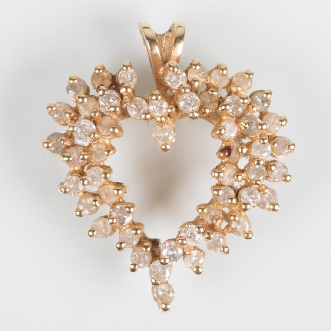 A 14kt. Yellow Gold and Diamond Heart Form Pendant,