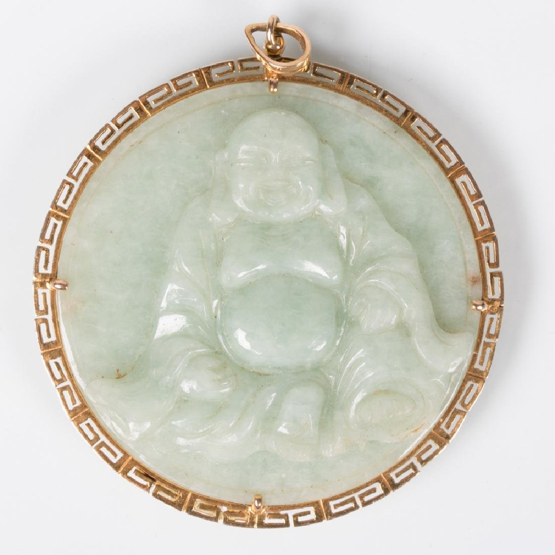 A 14kt. Yellow Gold and Carved Celadon Jade Pendant,