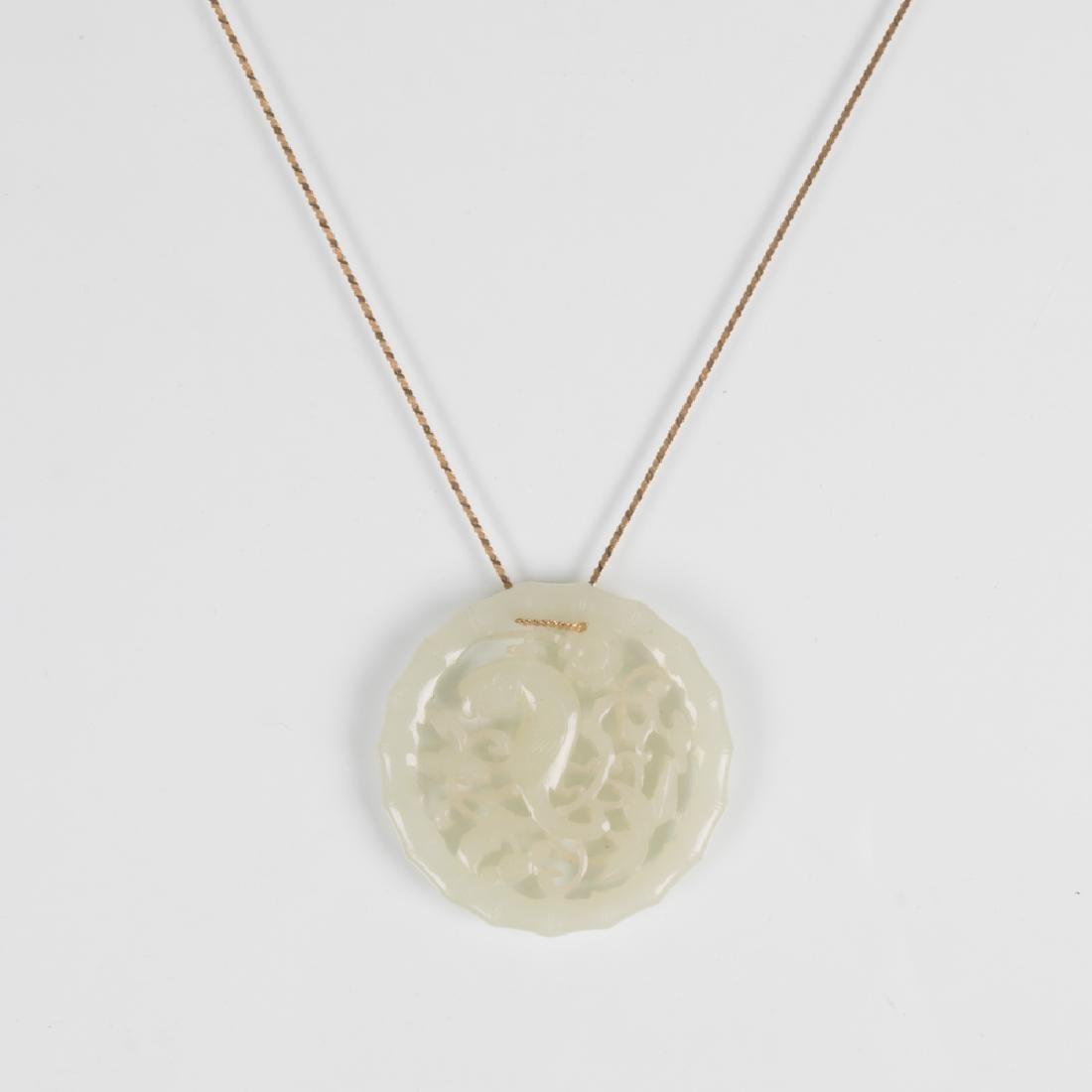 A Pierced Carved White Jade Pendant,