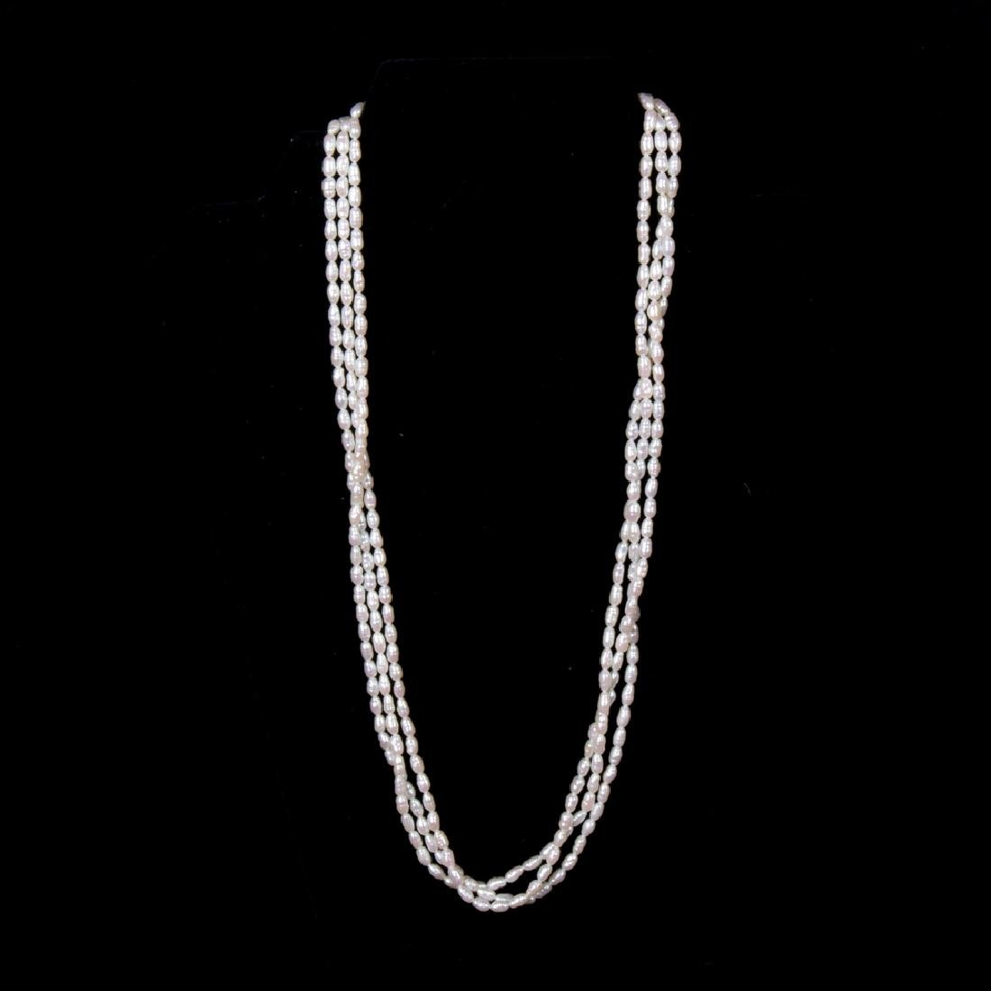 A 14kt. Yellow Gold and Baroque Pearl Triple Strand