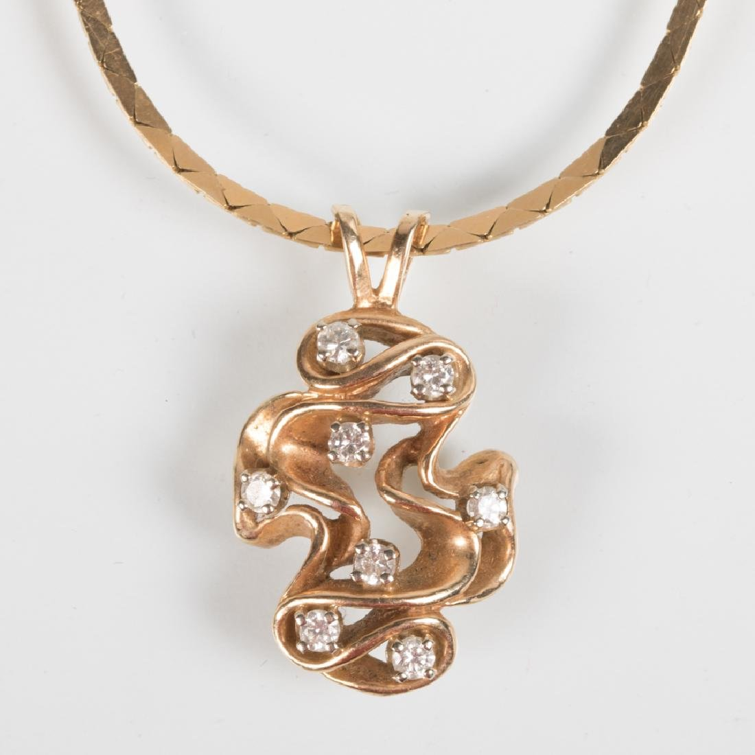 A 14kt. Yellow Gold and Diamond Pendant,