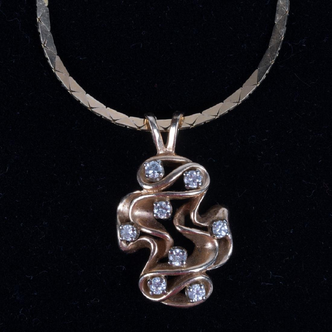A 14kt. Yellow Gold and Diamond Pendant, - 5