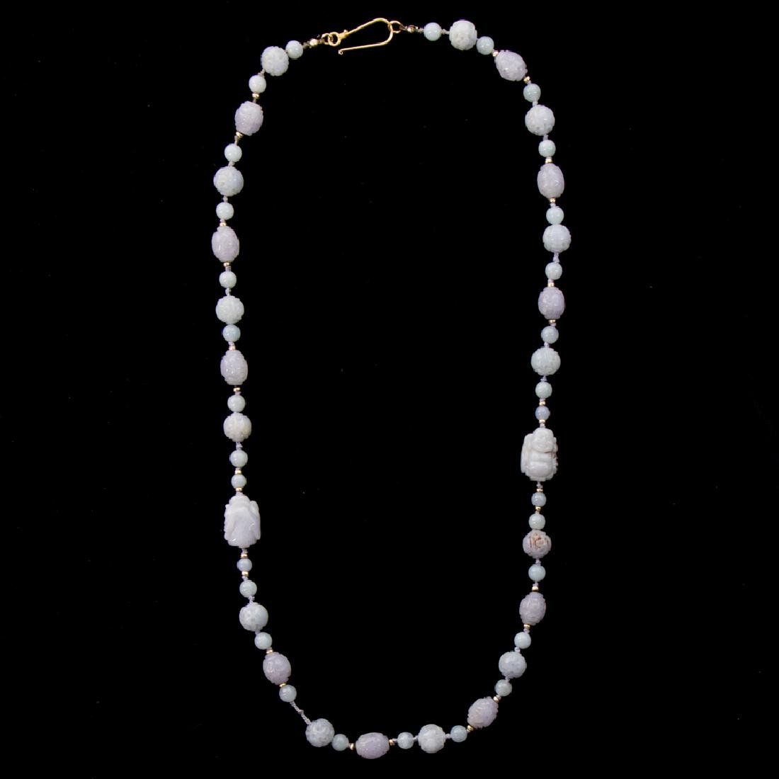 A Carved Lavender Jade Beaded Necklace,