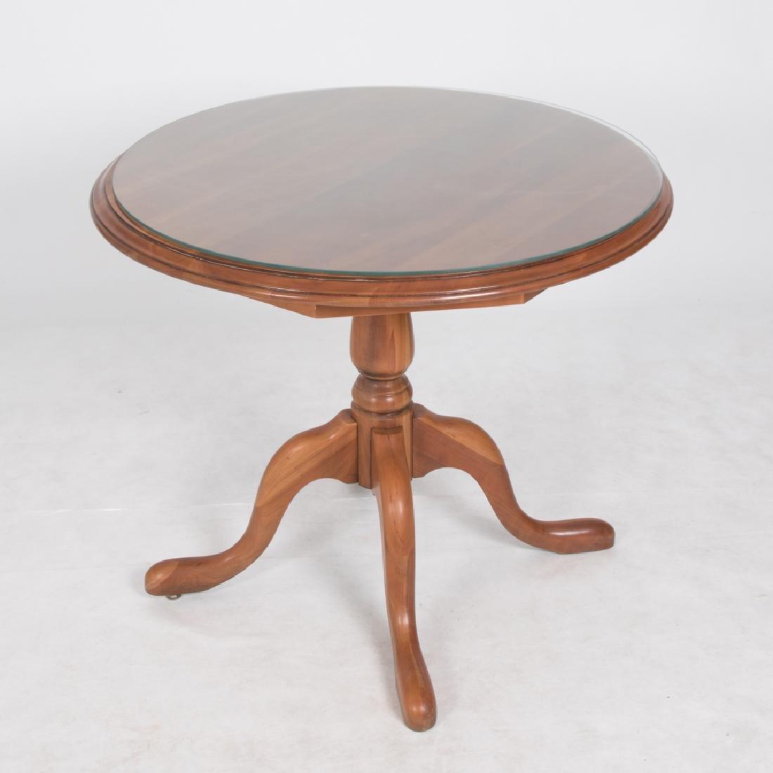 A Harden Cherry Circular Table, 20th Century,
