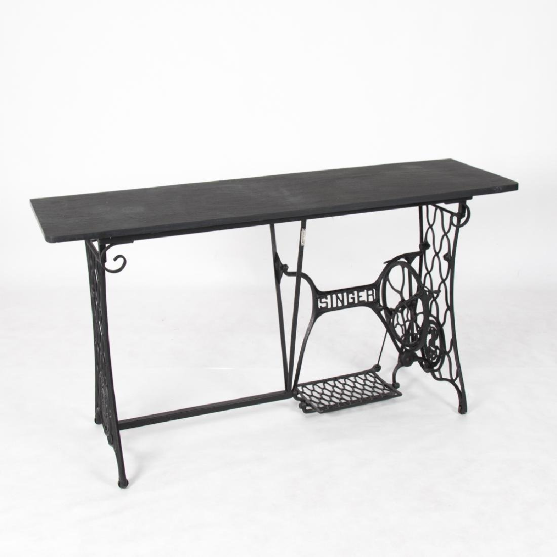 An Eric St. Regis Wrought Metal and Slate Console