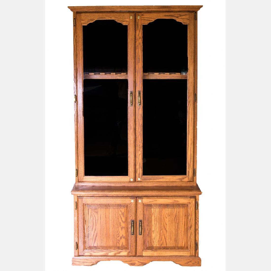 An American Oak and Glass Gun Cabinet, 20th Century.