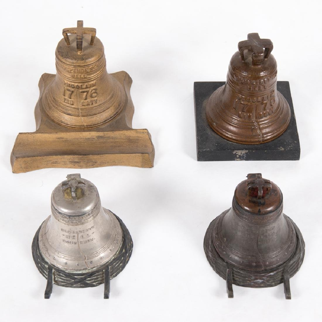 A Group of Three Metal Souvenir Inkwells in the form of