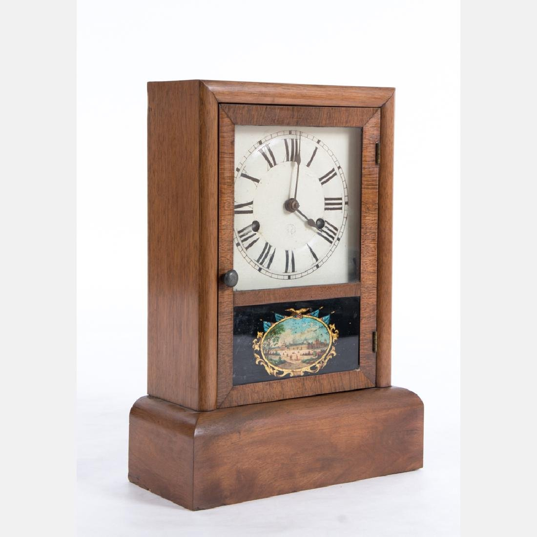 A Seth Thomas Oak Mantel Clock with Reverse Painted
