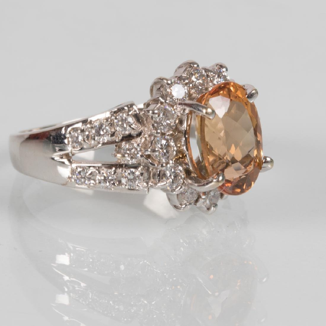 An 18kt. White Gold Topaz and Diamond Ring,