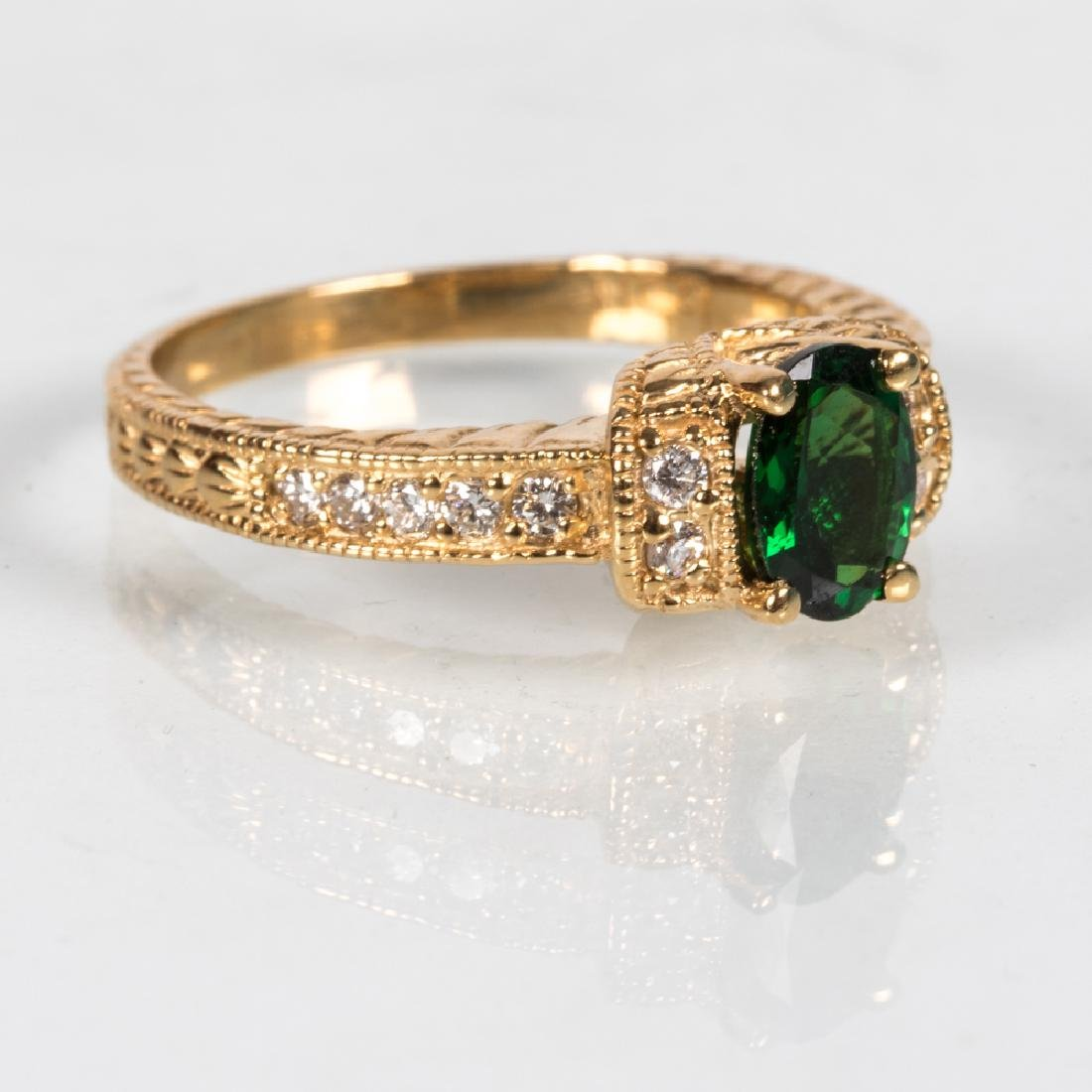 An 18kt. Yellow Gold Tsavorite Garnet and Diamond Ring,