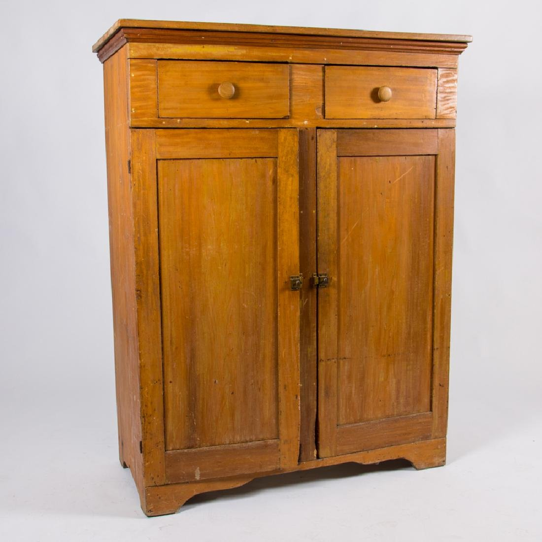 An American Pine Cupboard, 19th Century.