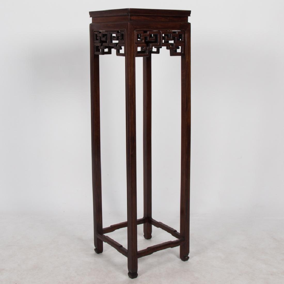 A Chinese Elm Pedestal, 20th Century.