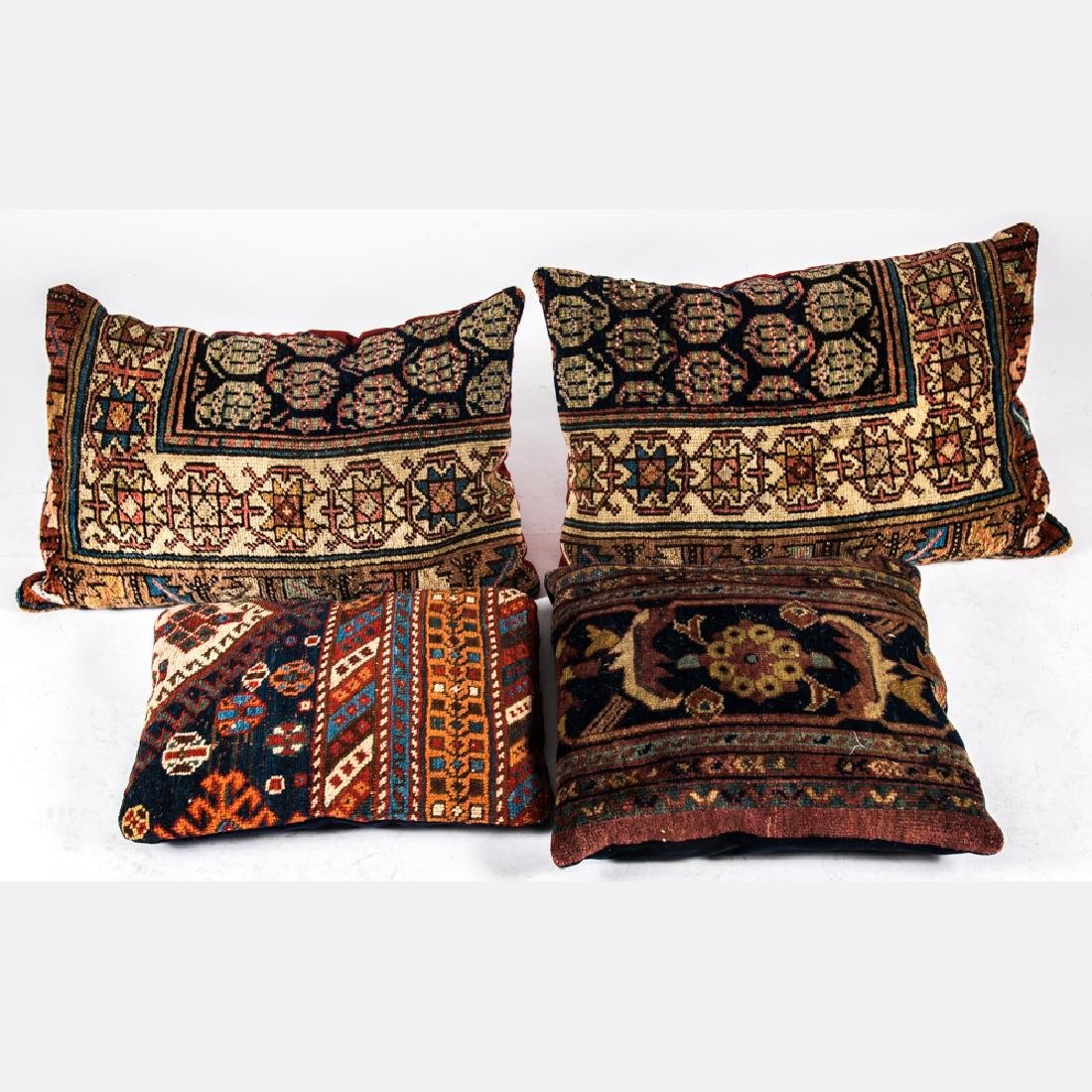 A Group of Four Rug Fragmented Upholstered Pillows,