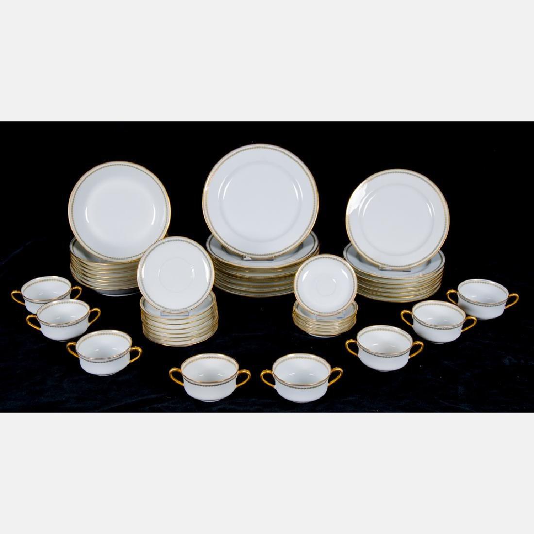 A Haviland Limoges Partial Porcelain Dinner Service,