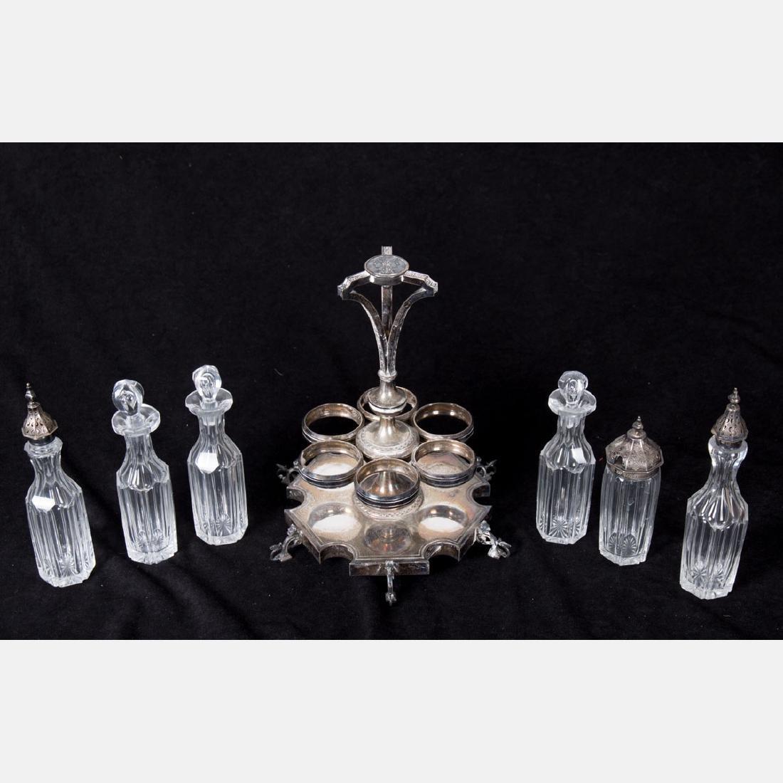 A Silverplated and Glass Cruet Set, 20th Century.