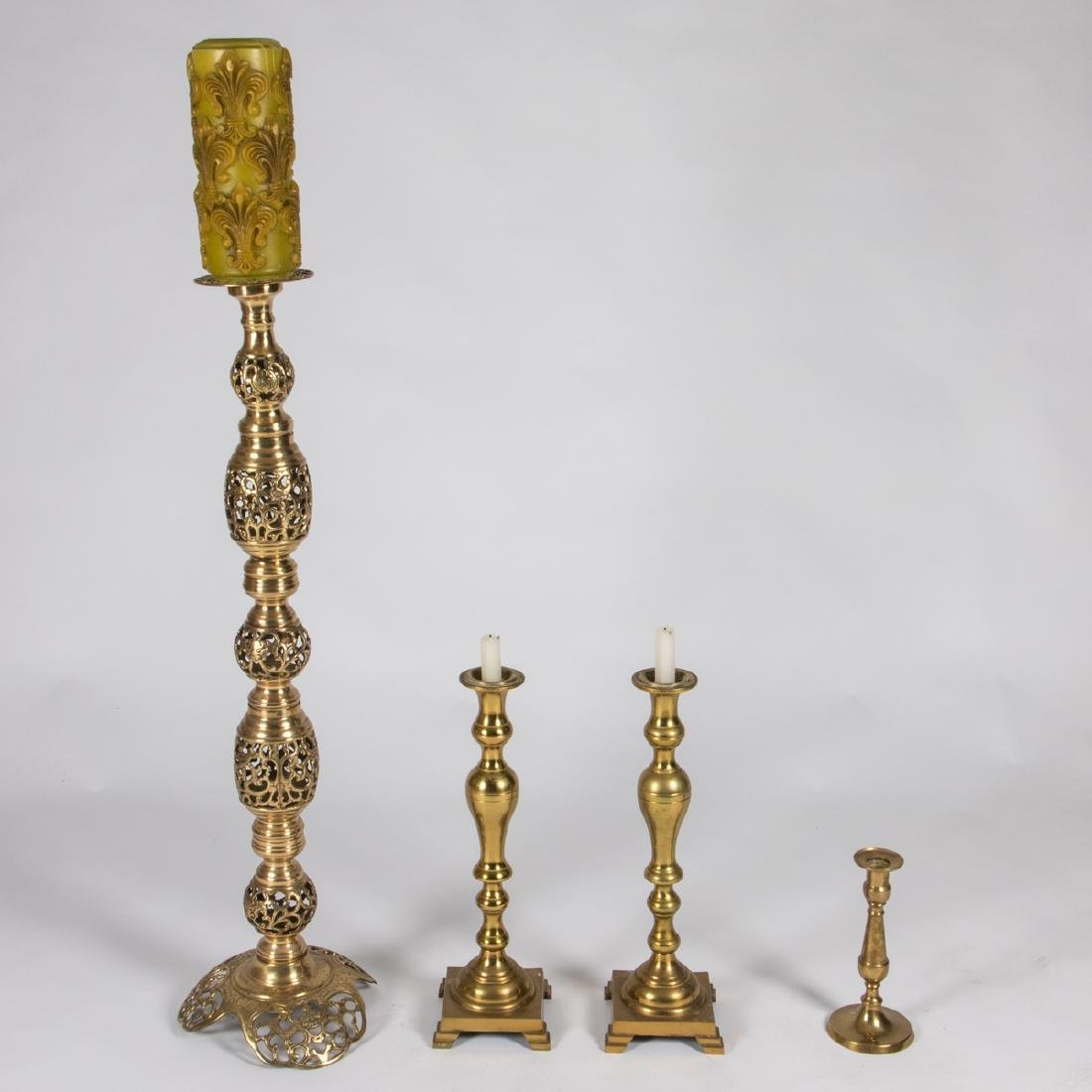 A Group of Four Brass Candlesticks, 20th Century,