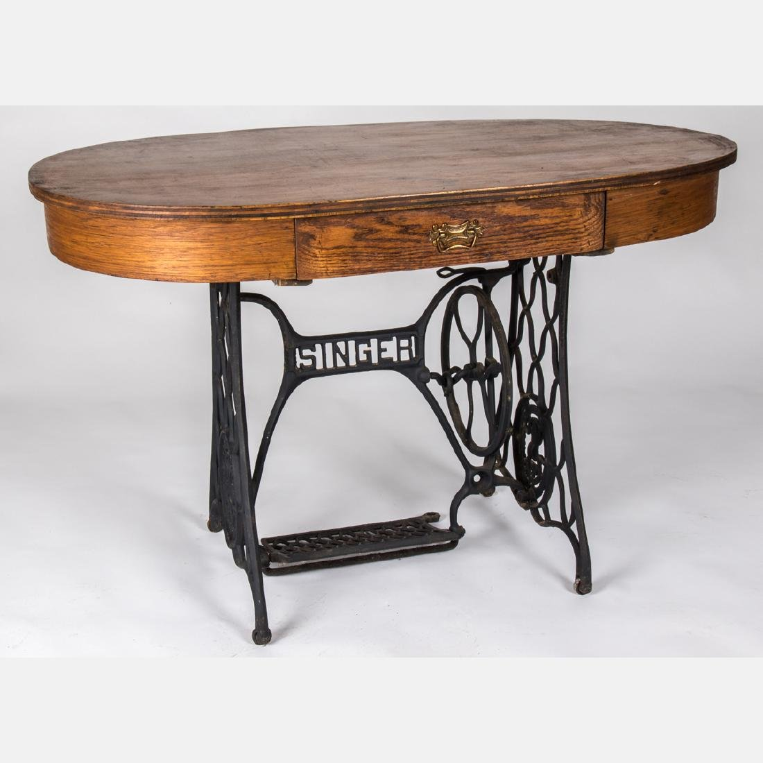 A Vintage Cast Iron Singer Sewing Treadle Base with Oak