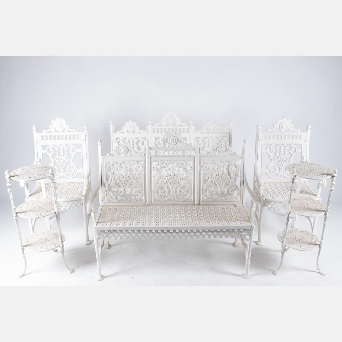 A Victorian Style Cast and Painted Aluminum Six Piece