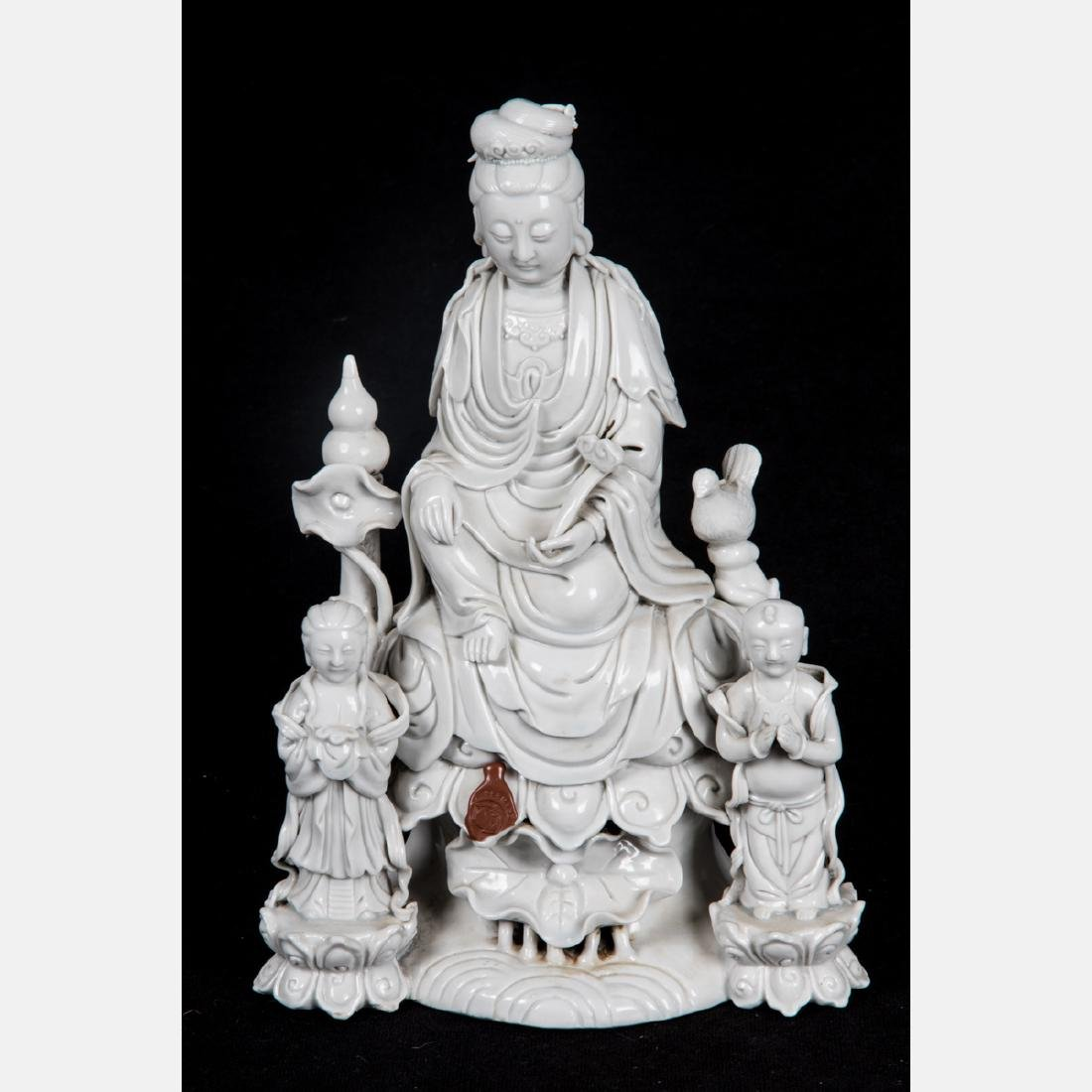 A Chinese Porcelain Blanc de Chine Figure of Guanyin