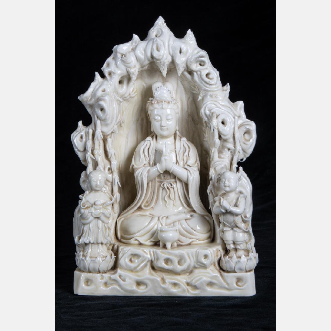 A Chinese Porcelain Blanc de Chine Figure of Guanyin,
